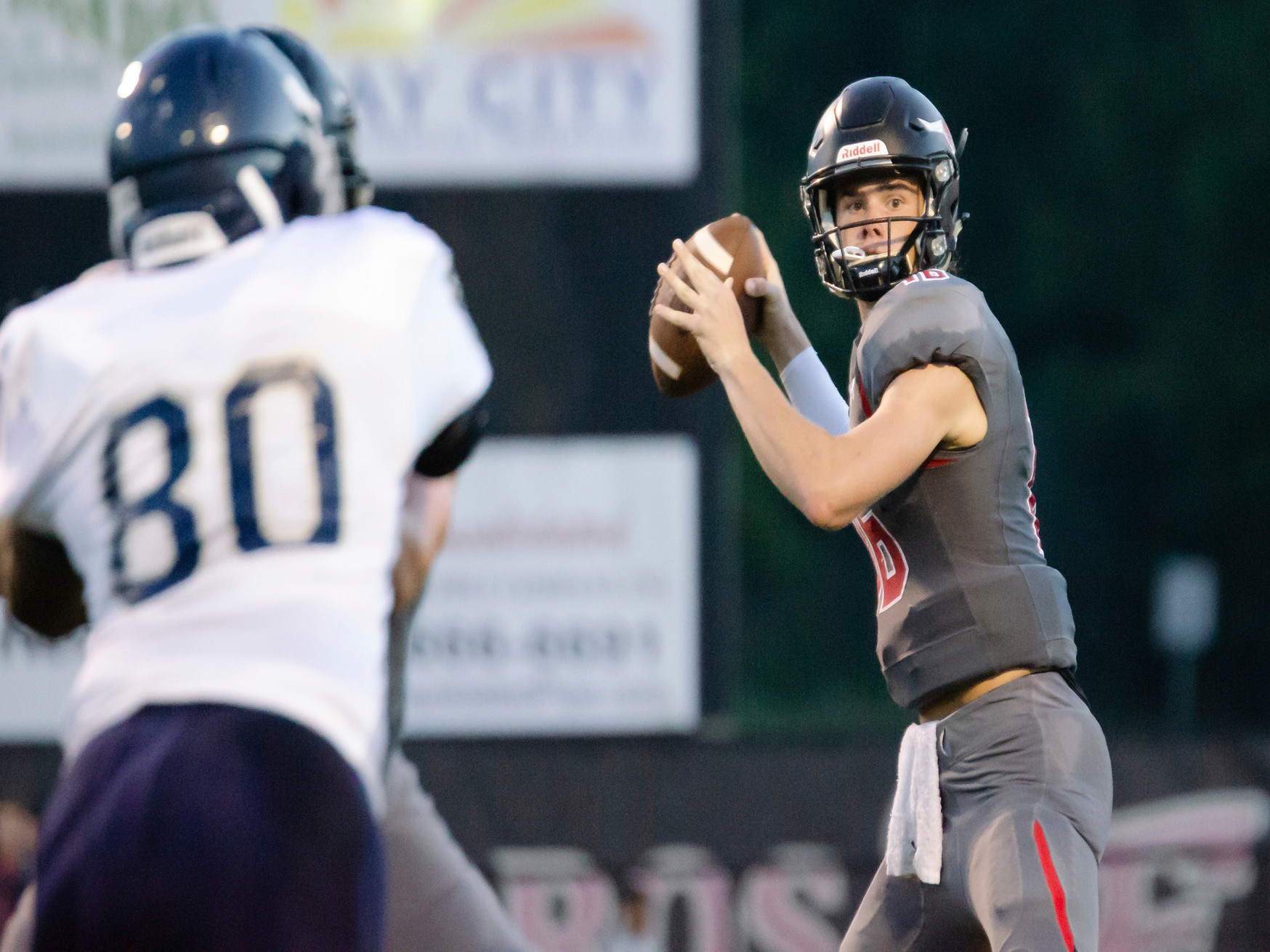 Jackson Burkhalter spots a Toro receiver downfield at Spanish Fort.