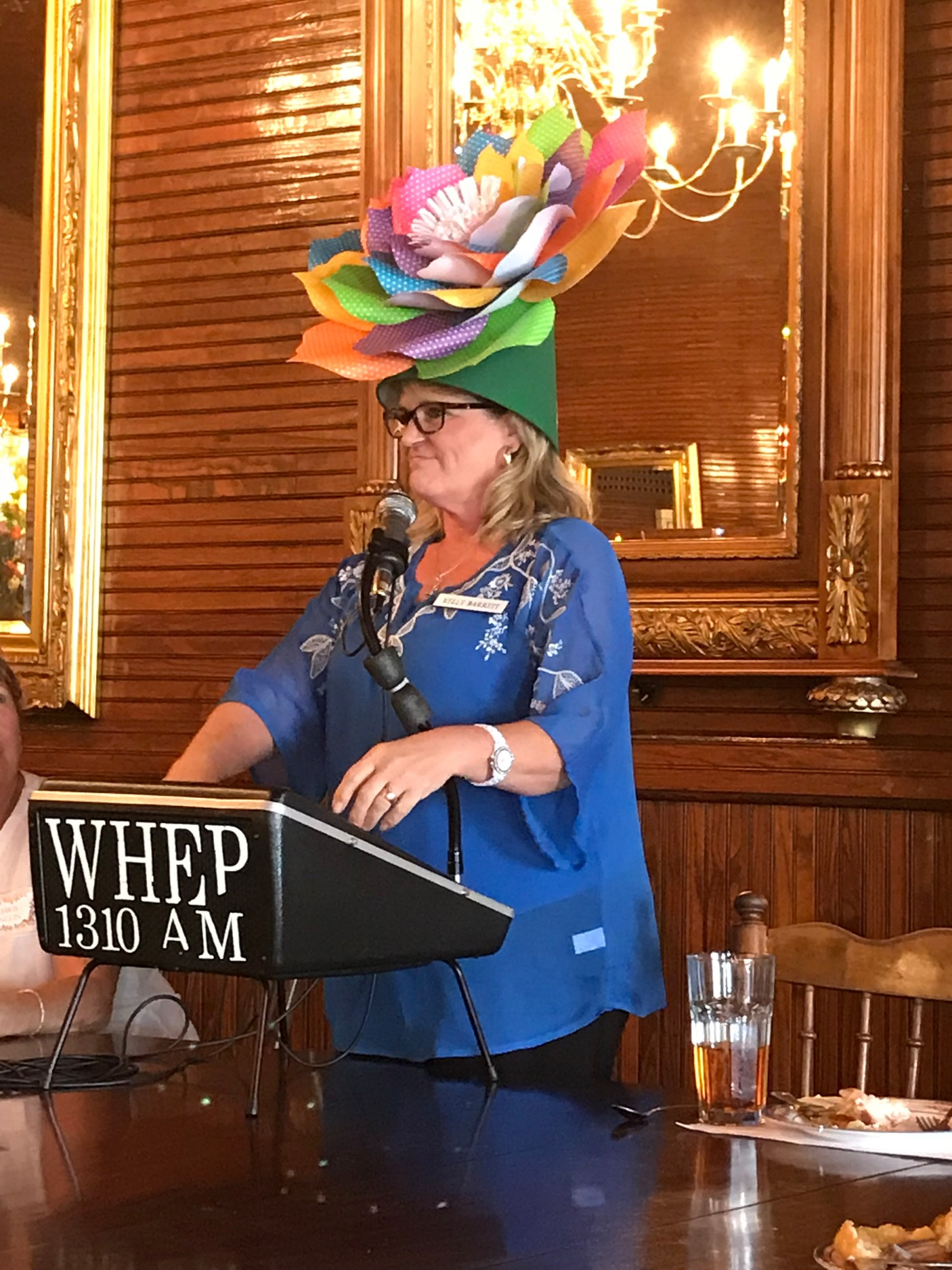 First Vice President Kelly Barrett announced the theme for 2019's Mad Hatters' Event: In The Garden.