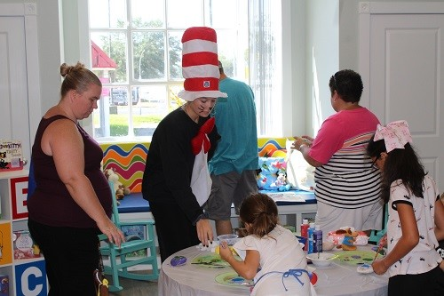 "The main character from Dr. Suess's ""The Cat in the Hat"" helps with children's activities during open house Saturday at the Loxley Public Library."