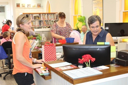 Resident Jessica Devine gets set up with Loxley Library Director Patty Hudson during open house at the library on Saturday
