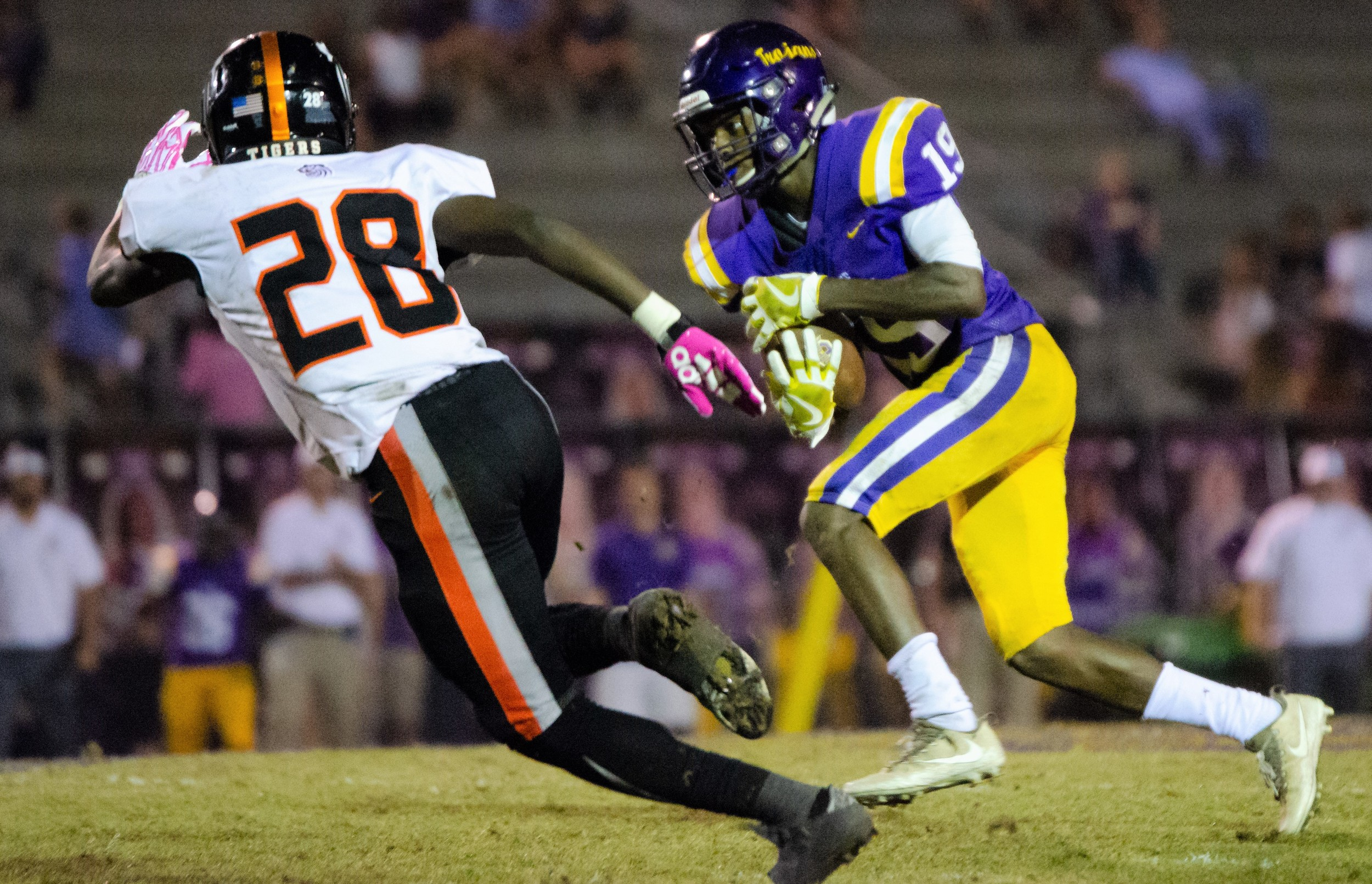 Keyon Palmer pursues DHS receiver Darius Johnson (19) at Jubilee Stadium.
