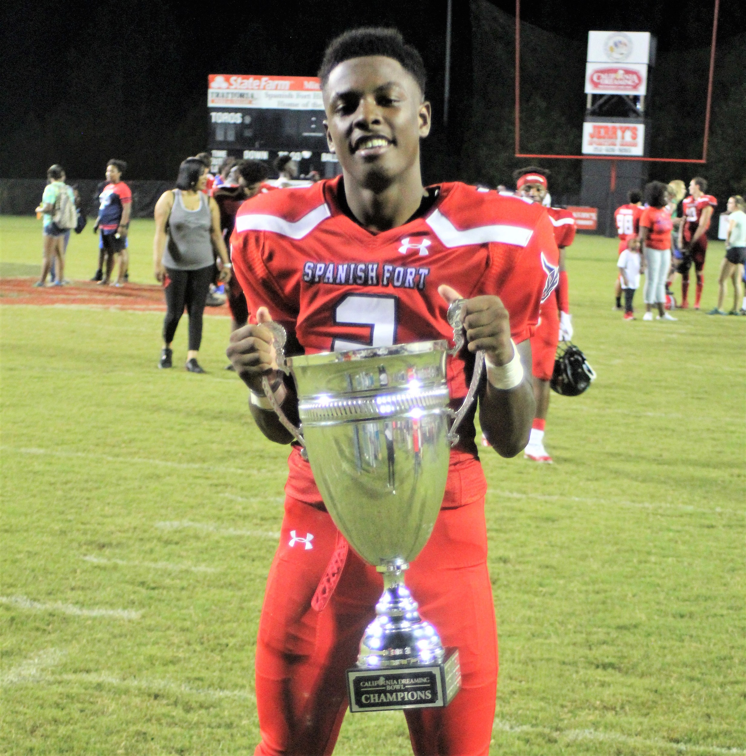 Spanish Fort corner back Desmond (DJ) James with the 2018 California Dreaming Bowl trophy.