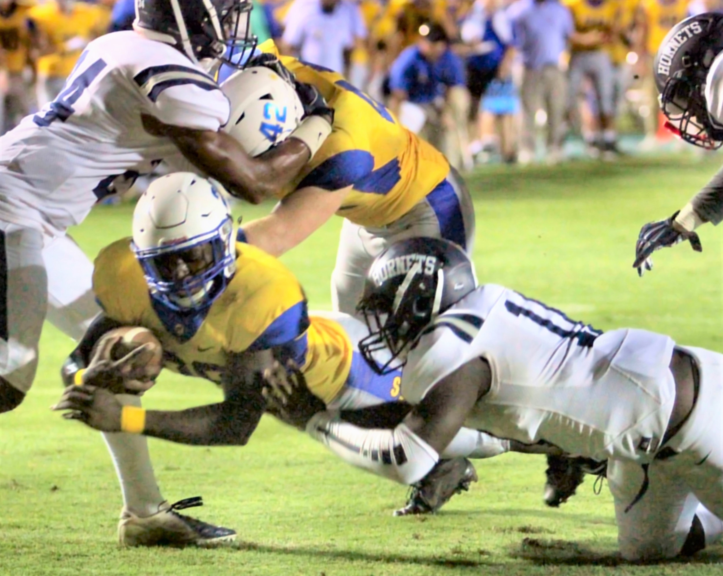 Damell Bell dives forward for Fairhope yardage.