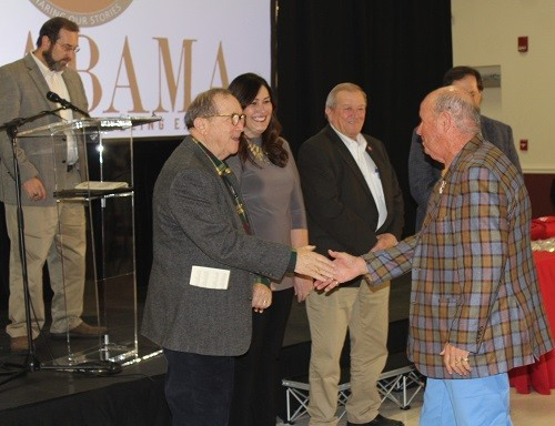 Heritage Family members were greeted by, from left, State Rep. Steve McMillan, county commissioners Billy Joe Underwood and Skip Gruber, and Dekeyser, before receiving pins from Baldwin County Administrator Ronald Cink.