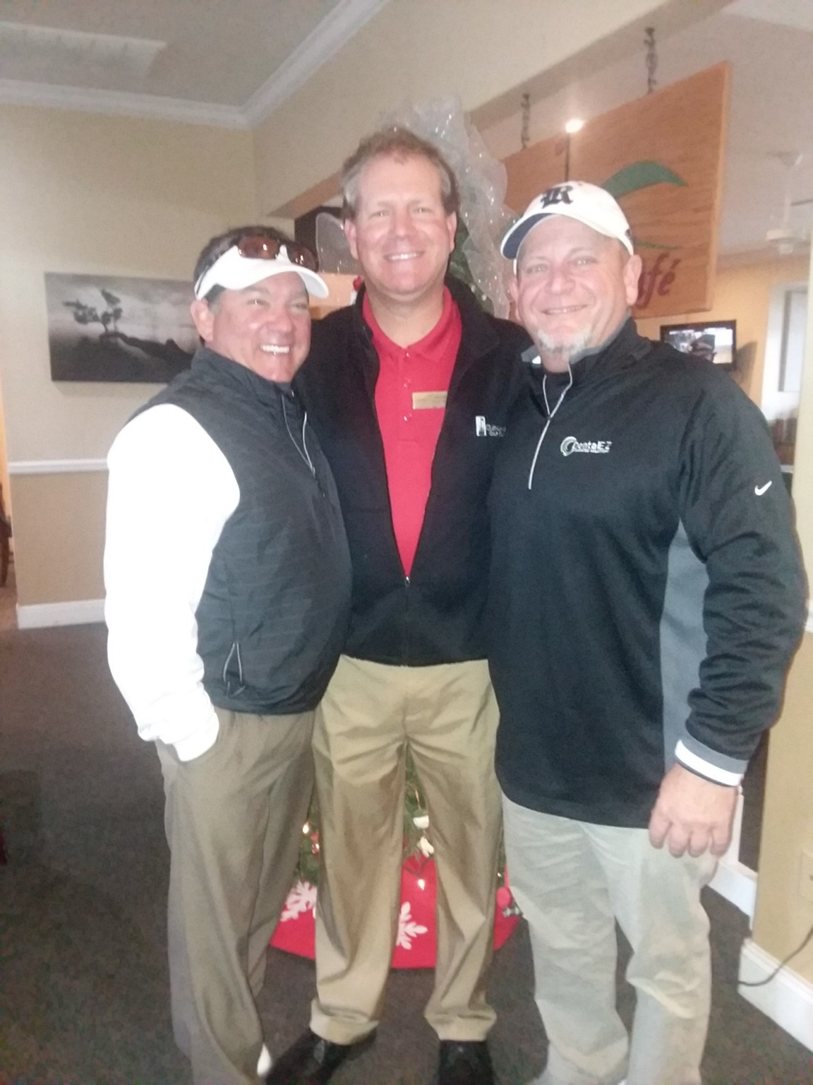 Pictured from left: Randy Burgan, Southern Fairways Radio Host, with David Musial, PGA General Manager, and Danny Spybey, Winter Open winner.