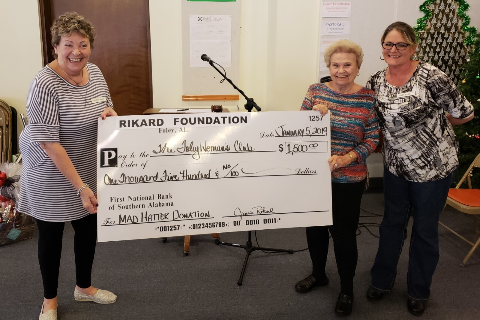 Chris Anglin and Kelly Barrett with Jennie Rikard presenting the generous check to the Club.