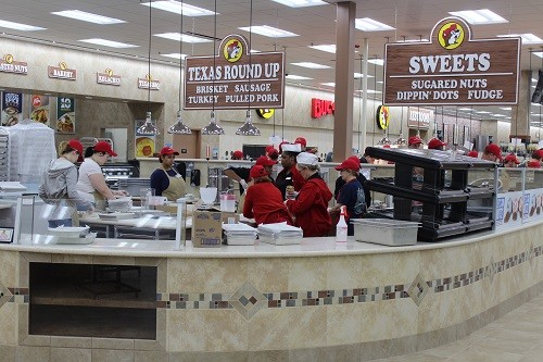 Buc-ee's includes a food bar which sells Texas brisket sliders, breakfast tacos and cinnamon-spice coated nuts.