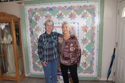 Pam (left) and Angie Madden with one of many quilts that will be on display at the 2019 Robertsdale United Methodist Women Quilt Show Jan. 31-Feb. 2.