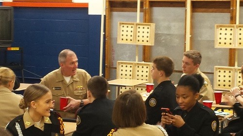 Cadets from Robertsdale High School and Elberta High School chat with U.S. Naval Commander Michael Bernacchi earlier this month in Pensacola. Cadets from the RHS NJROTC and Escambia (Florida) High School were invited to hear Bernacchi speak, followed by lunch in which cadets from RHS and EHS got to spend some individual time with Bernacchi.