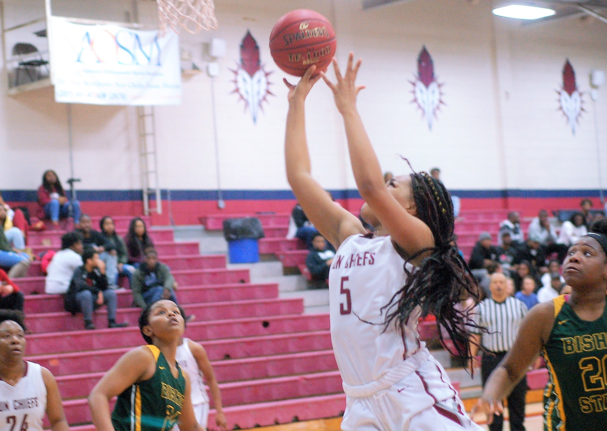 Adiya Matthews (5) drives to the hoop for Coastal South.