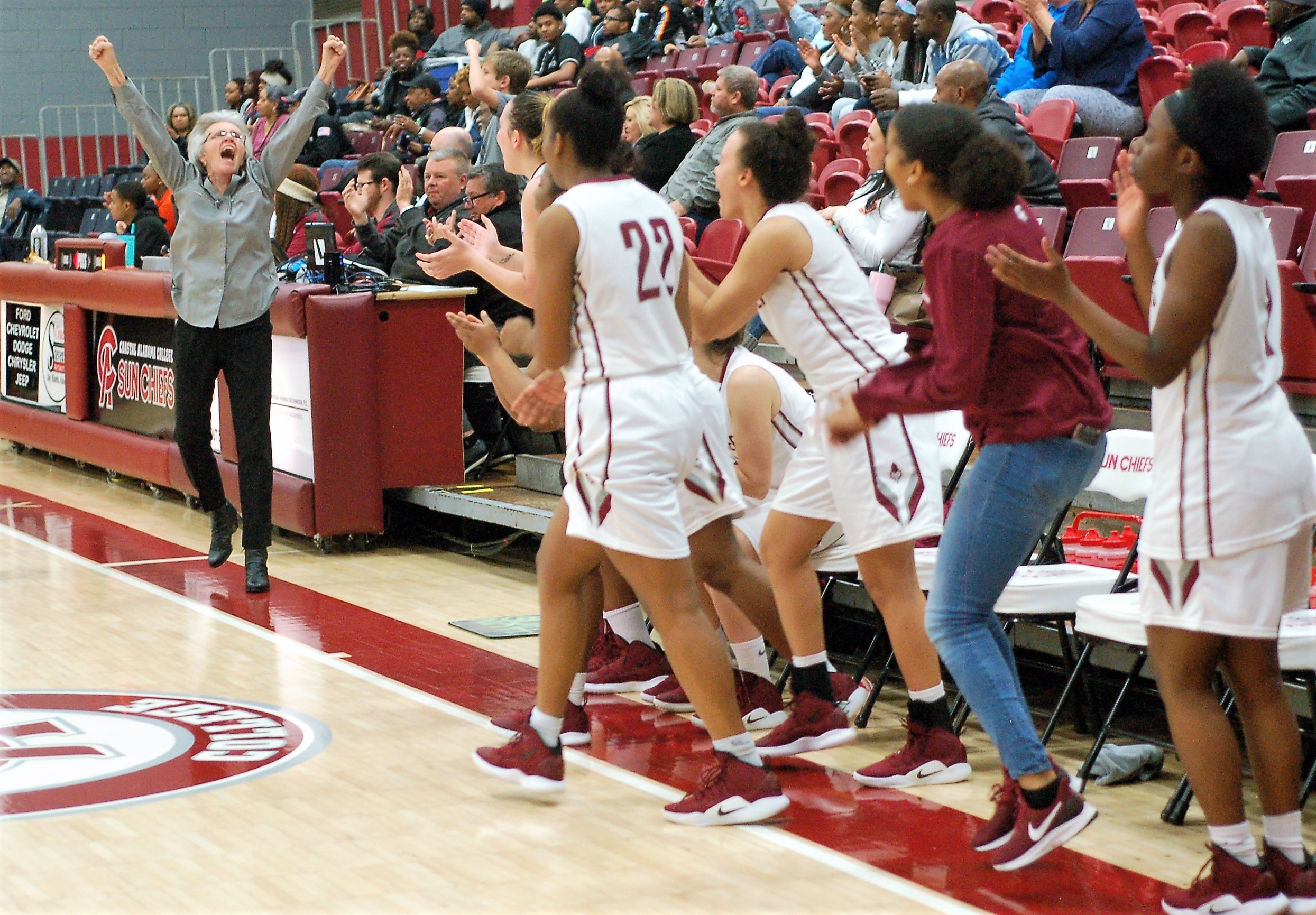 Head coach Linda Pitts and the Sun Chiefs react to their come-back win over neighboring rival Bishop State.