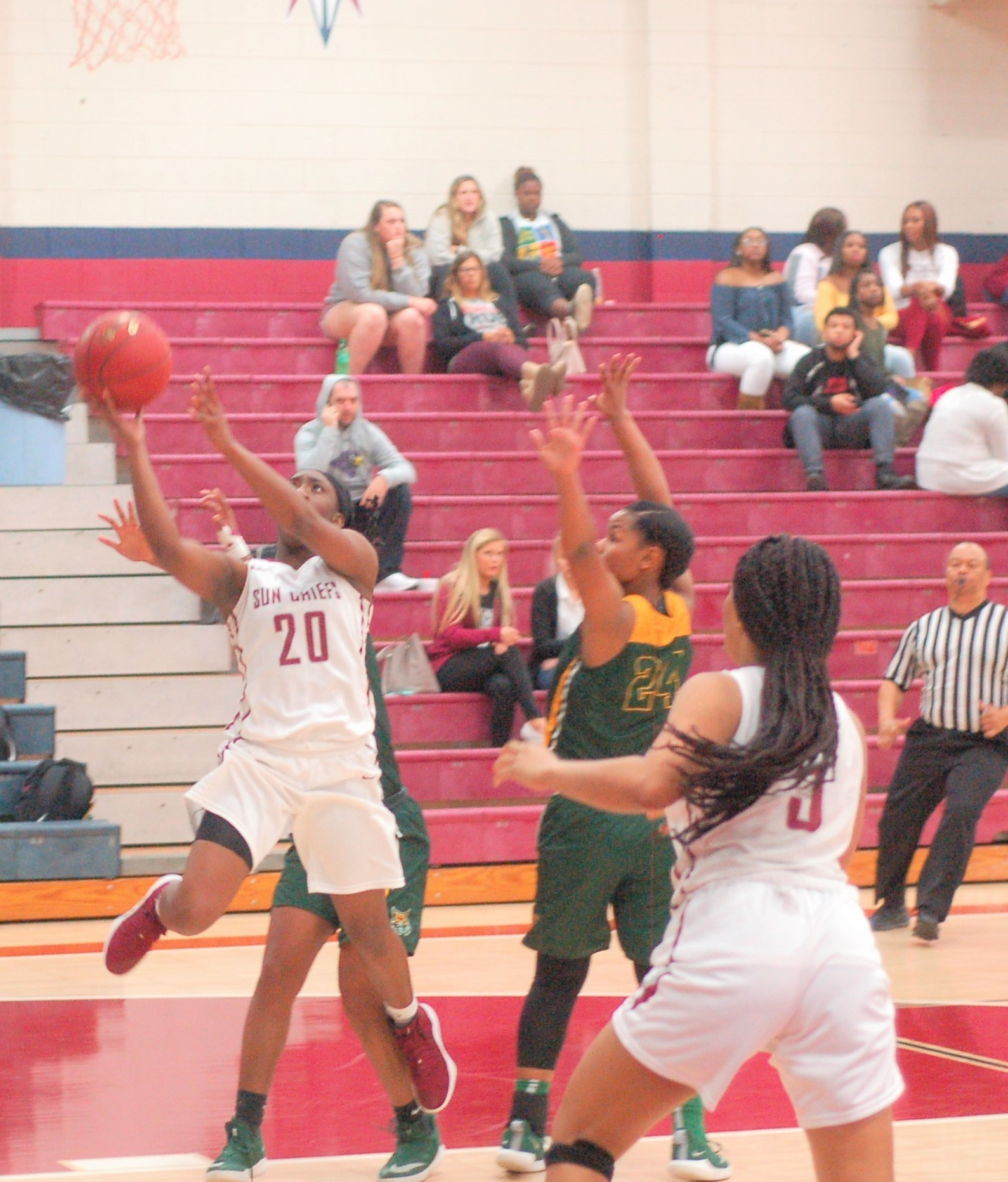 Kynadra Lewis (20) gets an inside look for Coastal South.