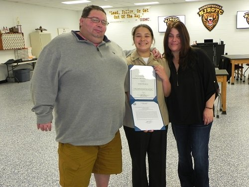 David Seladones (pictured with his wife Elaine and daughter) of Lillian credits his daughter, Sierra, with saving his life during a rafting trip in October. Sierra, a ninth-grade student at Elberta High School and a cadet seaman apprentice with the Robertsdale High School Naval Junior ROTC, was awarded the Meritorious Achievement Ribbon, the highest honor a cadet seaman apprentice can receive, during a ceremony held Wednesday, Jan. 30 at RHS.