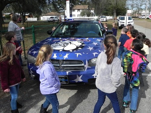 "Silverhill School students are given a ""tour"" on Friday, Jan. 25 of the school's new police cruiser by SRO Officer John Branscomb."