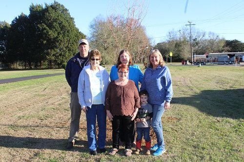Terry Simpson, far left, landscaping supervisor with the Robertsdale Public Works Department, join Park, Street and Tree Committee members in planting trees on city property. The city planted a corkscrew willow for this year's Arbor Day celebration. Pictured are Committee members, from left, Sue Cooper, Park, Street and Tree Committee Chairperson Sonja Connor, Cindy Adams, Ruthie Campbell and future Committee member Grady McDaniel. Not pictured are Committee members Amanda Brill, Jodee Darby, June Kennedy and Nell Callaway. Robertsdale will host its annual Arbor Day celebration on Saturday, Feb. 23 on the north end of Honeybee Park. This year the Park Street and Tree Committee will be raffling a corkscrew willow in celebration of Arbor Day and a bottle brush in celebration of Alabama's bicentennial, and giving away 1,200 other trees on a first-come, first-served basis.