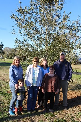 The city of Robertsdale Park, Street and Tree Committee recently planted a live oak on city property in honor of Alabama's bicentennial. Pictured with Terry Simpson, far right, landscaping supervisor with the Robertsdale Public Works Department, are Park, Street and Tree Committee members, from left, Ruthie Campbell (with future member Grady McDaniel), Sue Cooper, Cindy Adams and Park, Street and Tree Committee Chairperson Sonja Connor. Not pictured are Committee members Amanda Brill, Jodee Darby, June Kennedy and Nell Callaway.