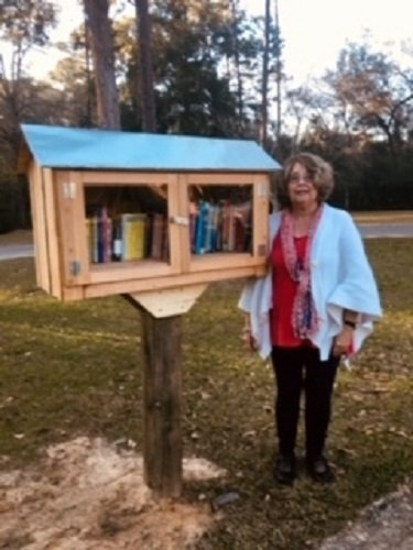 Carol Cleveland with the Little Free Library.
