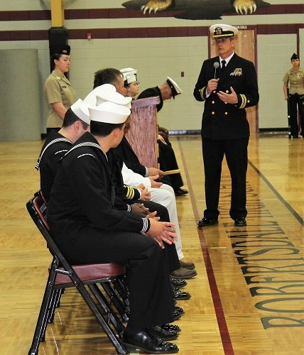 Lt. Commander Frank Star, senior Naval instructor at Robertsdale High School, addresses Naval and school officials during the annual Pass and Review held Wednesday, Feb. 27 at Robertsdale High School.