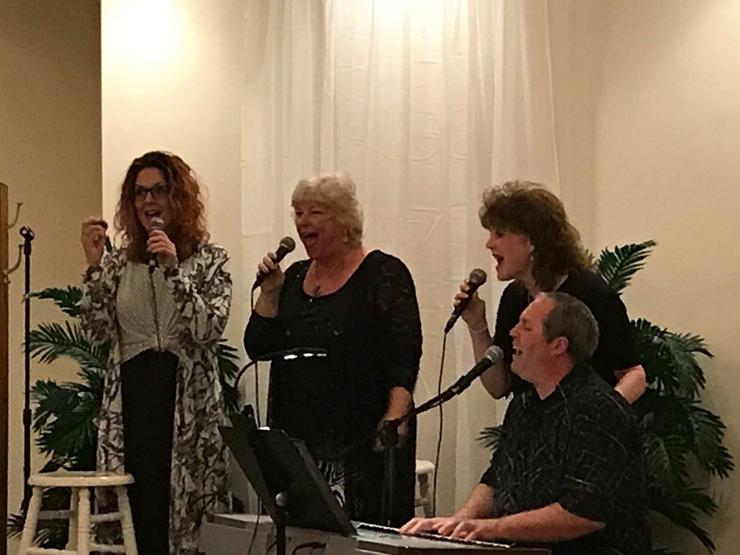 Local group Four A Change performing at the Hotel Magnolia in 2018. They will provide a free concert during the Lucky to Live in Foley celebration.