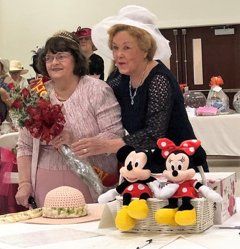 Evelyn Lowery, one of the main organizers for the Annual Tea Party, presents the crown to 2019 Queen Jeanette Dyess Ryan from the Class of 1952.