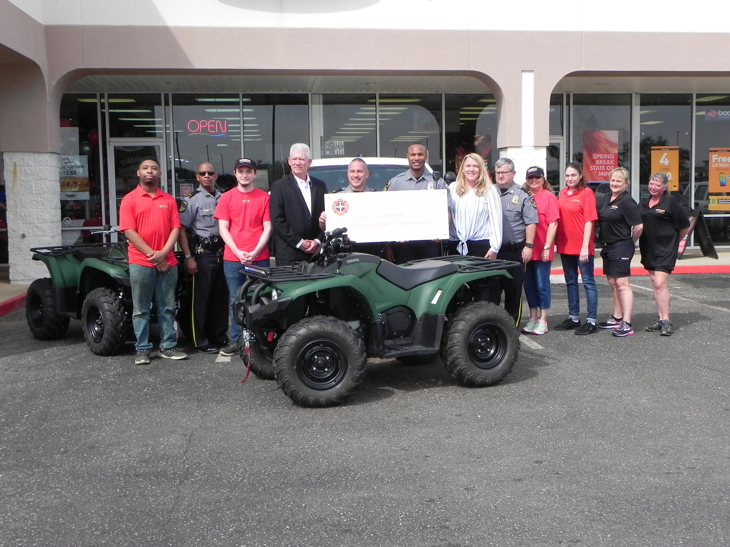 Foley PD officers, representatives from Firehouse Subs Public Safety Foundation, and Foley Firehouse Subs employees with the new ATVs donated to the Foley PD through a grant awarded by the foundation during a presentation at the Foley Firehouse Subs.