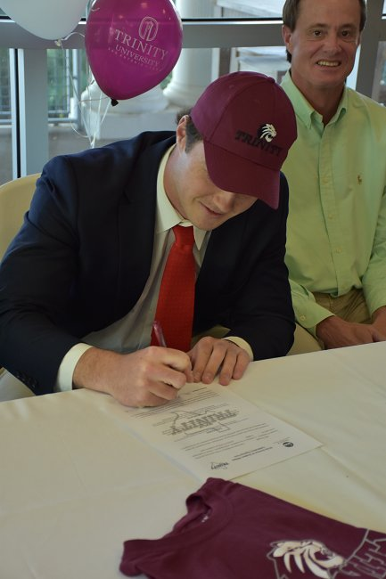 Mac Douglas signing his letter of intent to play football at Trinity University.