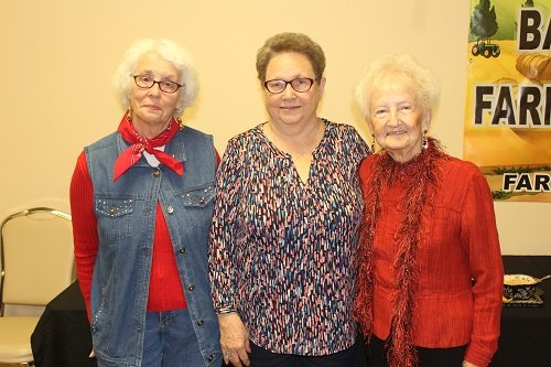 Tablescape winners, from left, Evelyn Wright, second place; Diane Sopr, third; and Carolyn Salac, pictured with Salac's winning entry.