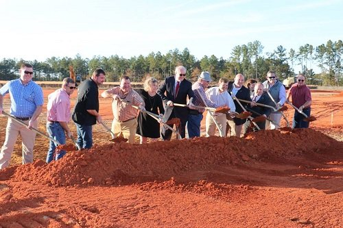 Construction is underway for the new T-hangars at the Bay Minette Municipal Airport. Pictured here are officials with the City of Bay Minette and Bay Minette Airport Authority breaking ground in December.