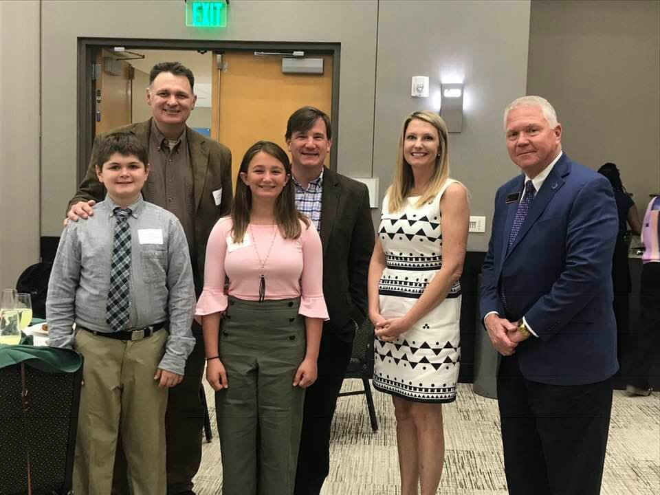 Fairhope Intermediate students Tucker Marlow and Sydney Gray traveled to Birmingham earlier this month with their fathers and Stock Market Club advisor, Christina Henson, to receive the first place award in the south division for grades 4 – 8. Superintendent Eddie Tyler joined the students at the ceremony.