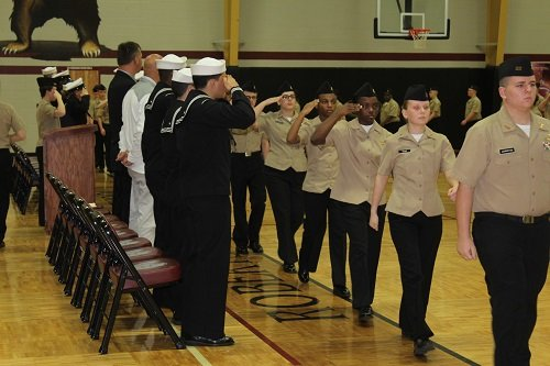 Robertsdale High School cadets parade in front of RHS and Naval officials during the annual Pass and Review.