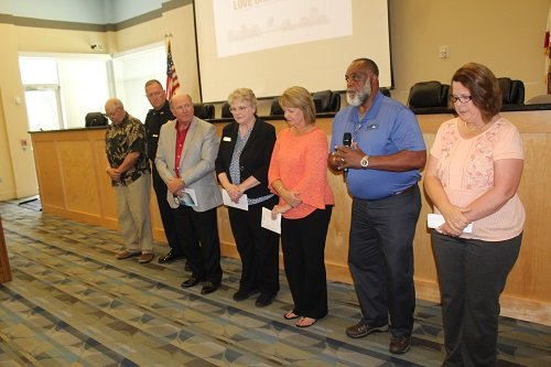 Presenting prayers, from left, John Taylor, media; Summerdale Police Chief Kevin Brock, first responders and military; Dennis Stastka, government and nation; Rebecca Shobe, business; Pam Taylor, education; Michael McGowin, the church; and Donna Armstrong, family.