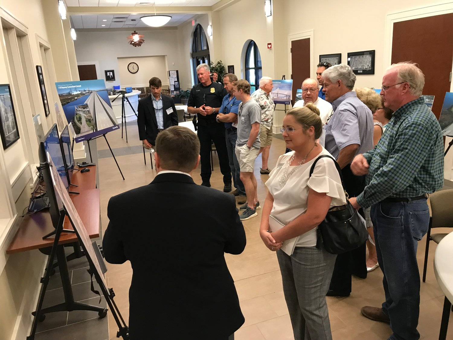 Eastern Shore residents look over plans for the $2-billion Mobile River Bridge at a hearing Tuesday in Spanish Fort.