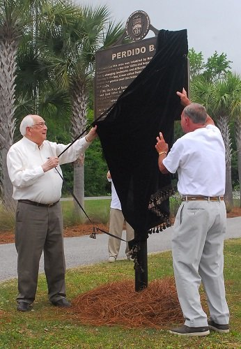 Former Congressman Jack Edwards and Harry Suarez unveil the Historical Marker located at the Lillian Boat Launch. Rep. Edwards was the Congressional Representative in 1980 when the current Lillian Bridge was dedicated. Harry Suarez is a descendant of the Suarez family who received the Land Grant from the King of Spain in 1780.