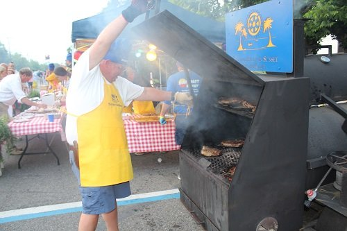 Baldwin County Sheriff Hoss Mack cooks up steak for the Central Baldwin Sunset Rotary team.