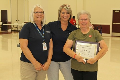 Council on Aging Volunteer of the Year recipient Pat Dunbar, right, of the Loxley S.A.I.L. Center is pictured with S.A.I.L. Center Manager Betty Dryden, left, and Council on Aging Coordinator Kelly Childress.