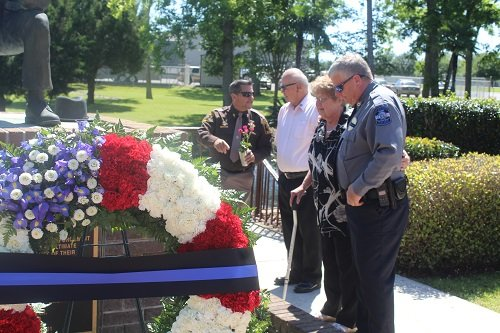 Families of fallen officers were invited to place flowers on the memorial.