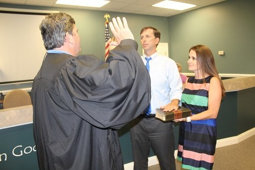 Jared Lyles, with wife Christie, is sworn in May 20 as Silverhill mayor by Municipal Court Judge Ken Raines.