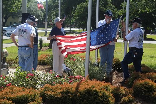 Veterans raise the flag Monday, May 27 at the Silverhill Veterans War Memorial honoring those who made the ultimate sacrifice for our country.