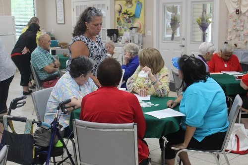 Vivian Barton, event coordinator with the South Alabama Regional Planning Commission, explains rules of qualifying to participants in this year's double dominoes qualifier held Wednesday, June 5 at the George P. Thames Adult Activity Center in Robertsdale.