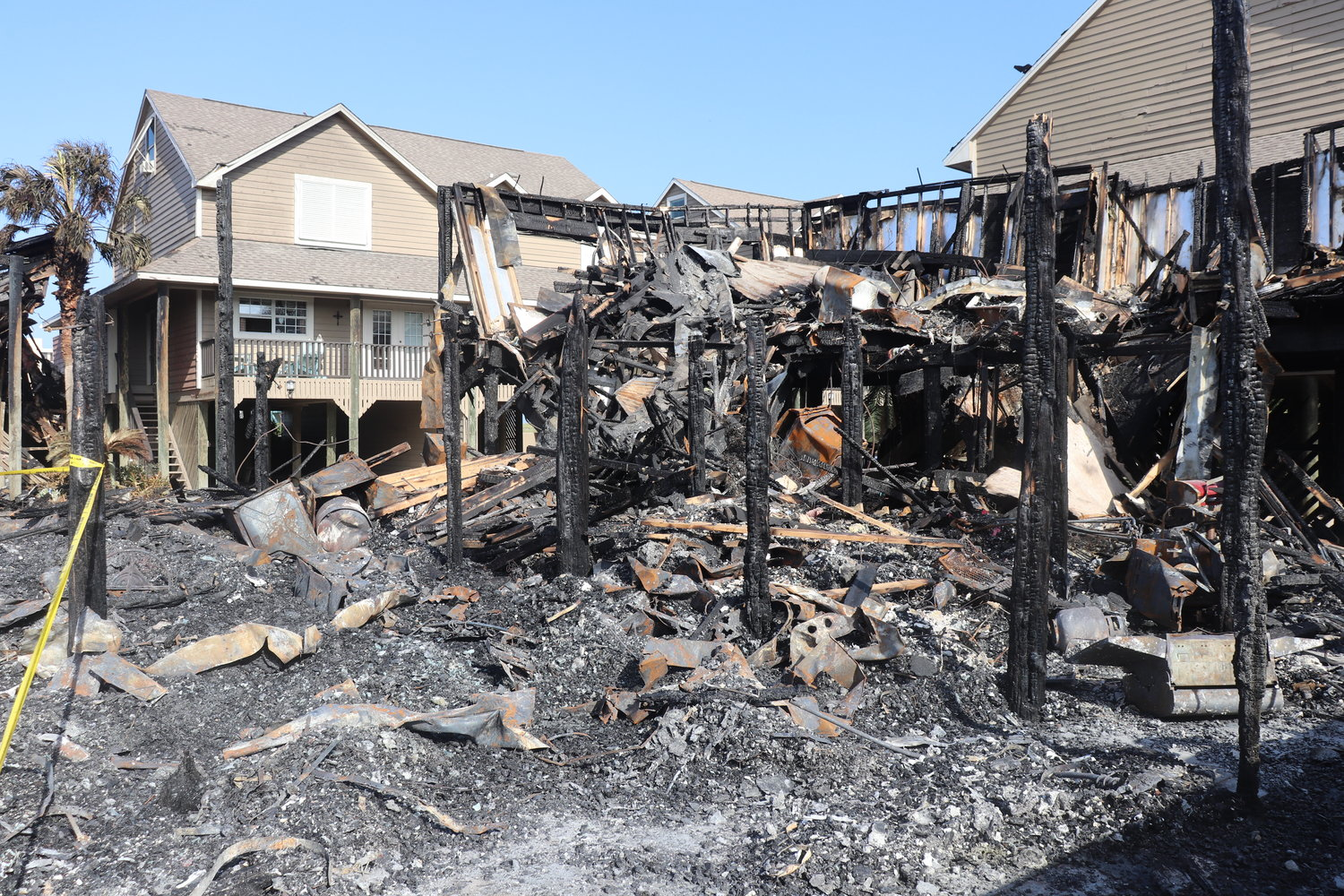 Flames engulfed 14 condominium units at Key Harbour and 12 units at Pescador Landing in the 17000 block of Perdido Key Drive on the Florida-Alabama line early Wednesday morning.