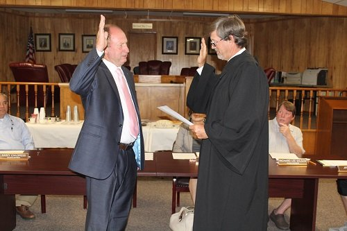 Loxley Municipal Court Judge Michael Dassinger performs the swearing in ceremony on Monday, June 24 for Loxley Mayor Richard Teal.