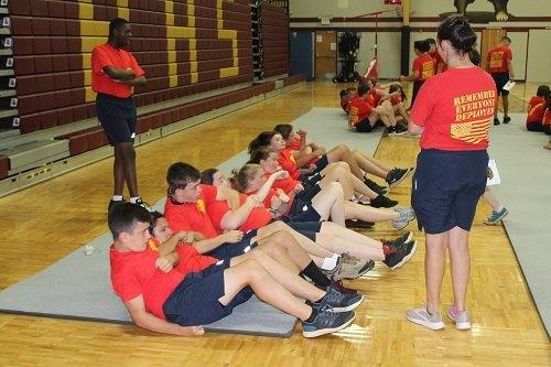 In it together. Incoming freshmen cadets with the Robertsdale High School Naval Junior ROTC learn teambuilding skills through exercises such as team sit-ups and tug-of-war competitions during freshmen orientation held July 8-12 at RHS.