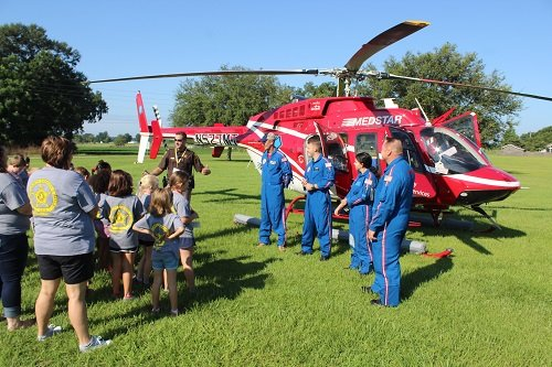 Sgt. Jacob Hill introduces campers to crew members of MedStar's Air Care One.