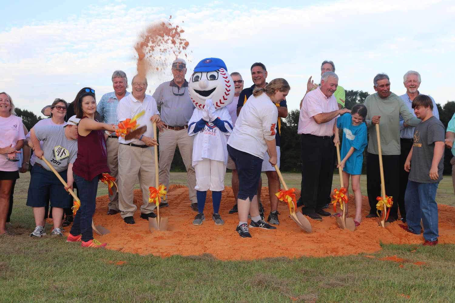 Supporters, committee members, community leaders and future athletes toss the first shovelfuls of dirt aside to mark the beginning of construction on the Miracle League of Coastal Alabama's stadium complex in Summerdale last week.