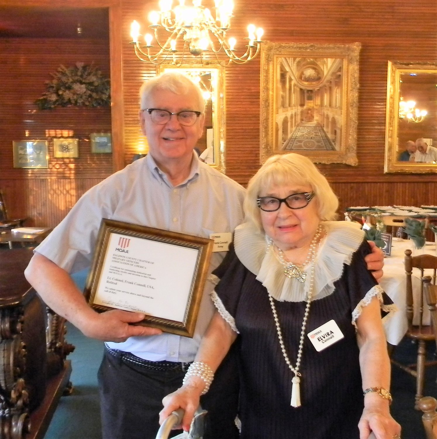 Lt. Col. Frank Connell, ret., and his wife Elvira Tautz Connell, of Fairhope, attend a ceremony last month in which Connell received a commemorative award for outstanding dedication and leadership to the M.O.A.A.
