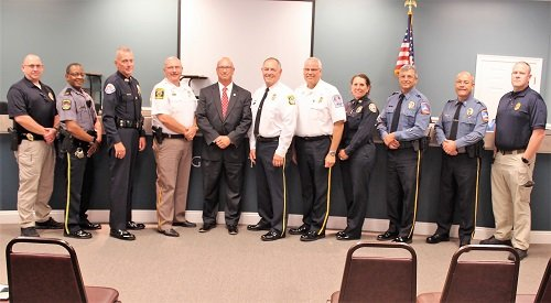 Law enforcement from throughout Baldwin County, including Sheriff Hoss Mack and Daphne Police Chief David Carpenter, attended the swearing-in ceremony for new Silverhill Police Chief Kenneth Hempfleng on Monday, Aug. 5 at Silverhill Town Hall.