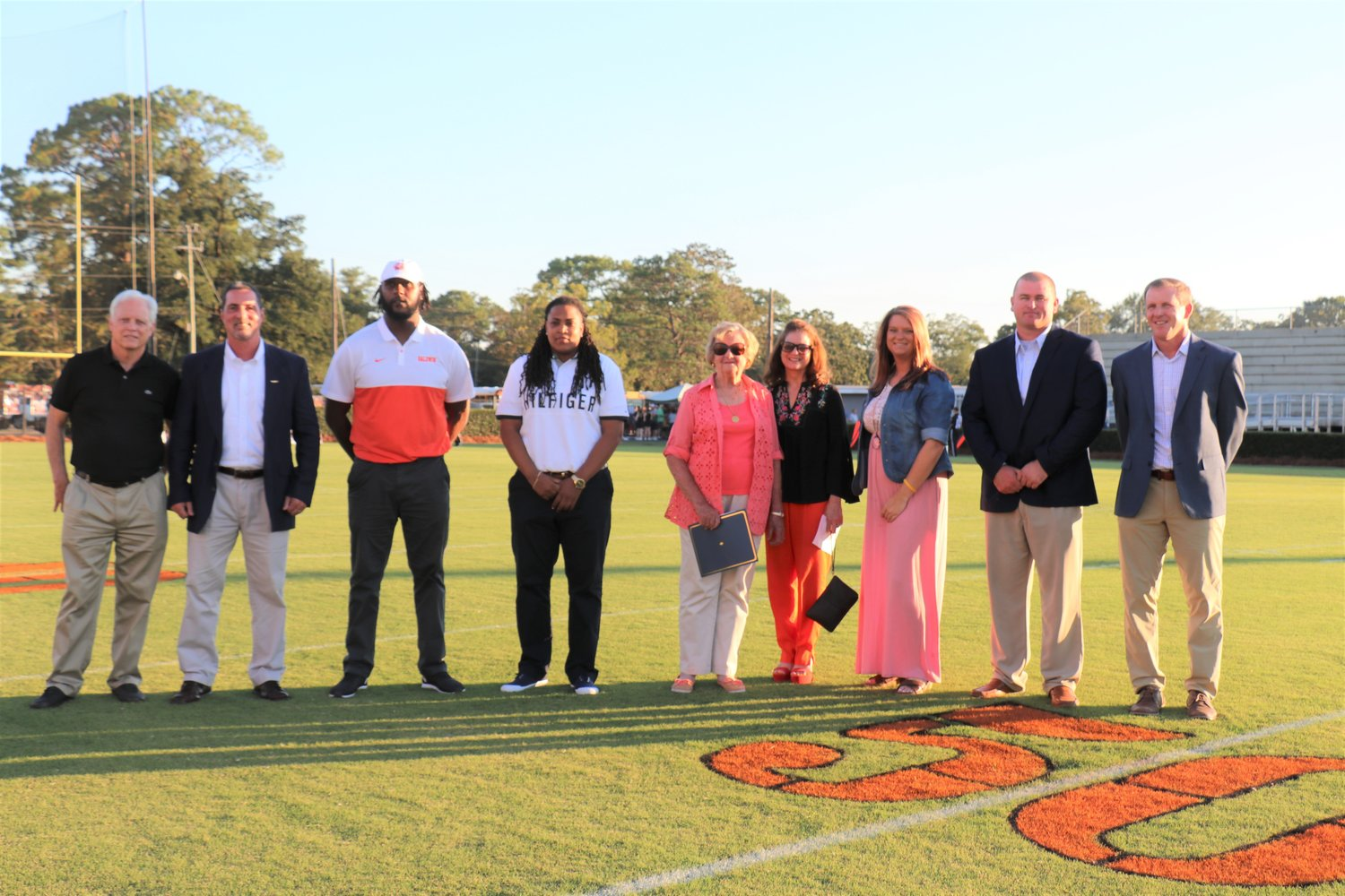 New BCHS HOF inductees introduced at halftime Aug. 30 include, from left, Ted Mashburn, John Perett, Anthony Mix Sr., Eartha White, Rowe Watson representatives Bobbi Weekley and Bobbie Maude Meacham, Whitney Thompson, Lee Huggins and Chad Harrelson.