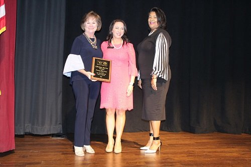 Frances Holk-Jones, left, receives the first United Way Lifetime Service Award from United Way of Baldwin County Executive Director Marina Simpson and 2019 UWBC Board Chairman Patrice Davis.