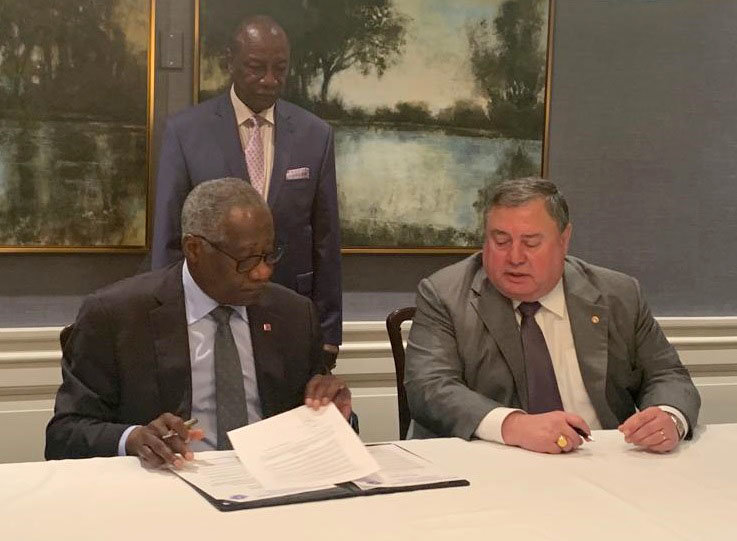 With the President of Guinea H.E. Dr. Alpha Condé looking on, Guinea Foreign Minister H.E. Mamadi Touré, left, and United States Sports Academy President Dr. T.J. Rosandich signed a Protocol of Cooperation to aid in sports development in the west African nation.