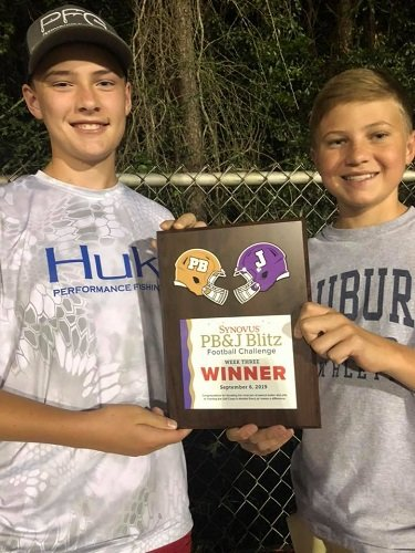 BCHS students Langston Lewis and Mason Smith show off the plaque.